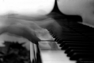 playing piano black and white